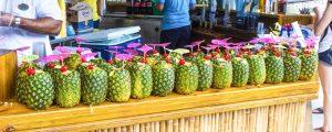 haiti bar panorama 300x120 - Labadee, Haiti - May 01, 2018: Cocktails In Pineapple On The Bar At The Beach At Sunny Day At Haiti