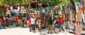 haiti marknad panorama 300x124 - Labadee, Haiti - May 01, 2018: Handcrafted Haitian Souvenirs And Painting At Sunny Day On Beach At I